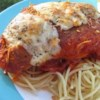 Tomato Chicken Parmesan Recipe and Video - A double cheese effect, as Parmesan-coated chicken swims in a pool of pasta sauce with a blanket of melted Monterey Jack over all.