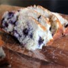 Blueberry Lemon Loaf Recipe - Freshly grated lemon zest, fresh lemon juice, and frozen blueberries bring bright flavor to this bread, and sour cream in the batter ensures a moist loaf.