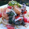 Exchange Gang Pasta with Shrimp Recipe - Creamy shrimp sauce with spinach, mushrooms, and tomatoes over spaghetti is the tasty result of a friendly challenge to cook Keri from her pals on the Recipe Exchange.