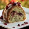 Cranberry Swirl Coffee Cake Recipe - This old family recipe is delicious for breakfast on Thanksgiving day, or to eat while watching the parade! Plain yogurt can be substituted for sour cream.