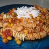 Southwestern Vegetarian Pasta Recipe - Tomatoes, chickpeas and corn are simmered with chili powder and cumin and served over pasta.