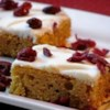 Colonial Pumpkin Bars Recipe - These moist pumpkin bars spread with cream cheese frosting are suitable to serve as finger-food.