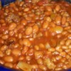 Texas-Style Baked Beans Recipe and Video - Not your usual baked beans! Green chiles and hot pepper sauce give zest to these eat-'em up sweet-and-hot baked beans.
