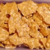 Microwave Peanut Brittle Recipe and Video - Salted peanuts in a sugary, crunch candy.  All the cooking is done in the microwave, then just pour it onto a cookie sheet, let it cool, break it off and eat it.