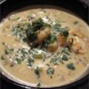 Shrimp Chowder Recipe - Cream cheese, milk and dry white wine form the base for this shrimp and potato chowder with sauteed chopped onions and celery.