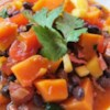 Brazilian Black Bean Stew Recipe - Sweet potatoes, mango, black beans, and cilantro are featured in this flavorful stew from South America.