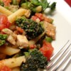 Pasta, Broccoli and Chicken Recipe - Chopped tomatoes and pesto add zesty flavor to blanched broccoli tossed with chicken and rigatoni. Parmesan cheese and a fresh grind of black pepper complete the dish.