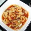 Tortellini Soup II Recipe - Link sausage and tortellini are cooked with tomatoes and shredded cabbage in a broth made with dry onion soup mix in this easy-to-prepare recipe.