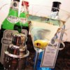 World's Greatest Martini Recipe - Both dry and sweet vermouth shaken with gin and ice, poured into your favorite martini glasses and garnished with pimento-stuffed green olives - what else?!