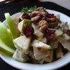 Apple Walnut Salad Recipe - Apples, walnuts, and cranberries in a creamy sauce make an excellent side dish for Thanksgiving or Christmas dinners!