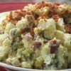 Red Skinned Potato Salad Recipe and Video - A creamy potato salad chock full of melt-in-your-mouth bacon, bits of hard boiled egg, crunchy celery and spicy onion.