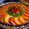 Fruit Pizza II Recipe and Video - A baked cookie crust is spread with cream cheese and whipped topping, and fresh fruit is spiraled onto the top. A sweetened, citrus glaze is then spooned over the fruit. Chill this sweet pizza before serving.