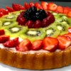 Fresh Fruit Flan Recipe - A beautiful fresh fruit tart with strawberries, blueberries and kiwi slices on a cream cheese filling.