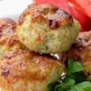 Turkey Veggie Meatloaf Cups Recipe and Video - Lightly seasoned lean ground turkey meatloaf muffins made with couscous and lots of grated zucchini, onion, and red bell pepper get a topping of barbecue sauce in this easy recipe. The individual servings are perfect for so many eating plans, and it's easy to grab a couple for a quick breakfast, lunch, or snack.