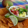 Quick Mango Salsa Recipe - This fruity salsa is great with pita chips. You could use it to top salmon or your favorite grilled fish, steak, or pork chop. You can add pineapple for even more of a tropical flair. The possibilities for this recipe are endless!