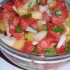 Watermelon Salsa Recipe - Watermelon, crushed pineapple, sweet onion, cilantro, orange juice and Tabasco make a refreshing summer twist on salsa. Bring copies of the recipe whenever you bring this, people will beg for a copy! Serve with tortilla chips.