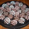 Easy Chocolate Chip Cookie Dough Truffles Recipe - Chocolate chip cookie dough truffles are simple to make.  Dip egg-free chocolate chip cookie dough in melted chocolate coating, and top with toffee pieces. Yum!