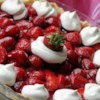 Fresh Strawberry Pie I Recipe - This is the prettiest strawberry pie. Choose berries that are large and of similar shape. Stand them up in a pre-baked pie crust and pour a strawberry gelatin glaze evenly over the top. Chill until set and serve with a bowl of freshly whipped cream.