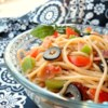 Sharese's Spaghetti Salad Recipe - Spaghetti, bacon, celery, onion, bell pepper, olives and tomatoes tossed with salad seasoning, Italian dressing and Parmesan and served cold.