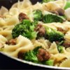 Italian Sausage with Farfalle and Broccoli Rabe Recipe - A beautiful two pan entree that'll please anyone who likes Italian sausage. Delicious with cheesy garlic bread and a sparkling white wine. My boyfriend and everyone in our families loves this dish!