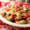 Pizza Salad II Recipe - This pasta salad has all the standard ingredients of a deluxe pizza!