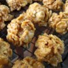 Peanut Butter Chews Recipe - These candies are made by boiling corn syrup and sugar with creamy or crunchy peanut butter.  Crushed corn flakes are added before these treats are hand molded into small balls.