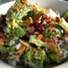 Broccoli Crunch Salad Recipe - This salad has bite, crunch and sweetness, combining raisins, nuts and crunchy broccoli with crisp bacon in a sweet and sour mayonnaise-based dressing.