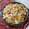 Roasted Pumpkin Seeds Recipe and Video - Fresh pumpkin seeds are roasted with butter in salt to make this popular seasonal snack.