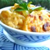 Creamy Au Gratin Potatoes Recipe and Video - Thinly sliced potatoes and onion are layered in a creamy cheese sauce creating the perfect au gratin potato recipe.