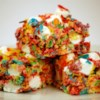 Fruity Krispy Treats Recipe - Vary your usual crispy cereal treat bars by using fruit-flavored cereal and marshmallows.