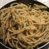 Sicilian Spaghetti Recipe - Anchovies sauteed with garlic and oil makes a pungently tasty sauce for hot spaghetti. Add some breadcrumbs and parsley to the anchovy mix and toss with the noodles to serve.