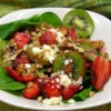 Strawberry, Kiwi, and Spinach Salad Recipe - What a wonderful surprise the dressing is in this refreshing salad. Raspberry jam is swirled into raspberry vinegar, and then mixed with oil. This luscious dressing is tossed with the kiwi, strawberries, walnuts and spinach. Makes eight servings.