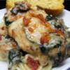 Chicken Florentine Casserole Recipe and Video - Boneless, skinless chicken breasts are topped with bacon bits and shredded mozzarella, then baked on a bed of spinach and mushrooms with a garlicky cream sauce.