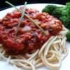 Stephanie's Freezer Spaghetti Sauce Recipe and Video - It took all summer to grow your tomatoes, now use a slow cooker to make them into a versatile tomato sauce flavored with sauteed onion, garlic and bell pepper, and seasoned with oregano, basil, parsley, sugar and tomato paste.