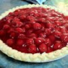 Cherry Cheese Pie I Recipe - Cream cheese and whipped topping folded together make this no-bake pie light and fluffy. This is a quick and easy dessert. For endless variations, use any flavor of pie filling as a topping! This recipe can be doubled for a 9x13 inch pan.