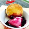 Blueberry Pie Pops Recipe - Delectable little 2-bite blueberry pielets on sticks will bring out the kid in you. Tuck one or two in a lunchbox, or sit a bunch up in a vase for people to take with their coffee. Cute and tasty wins the day!