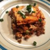Taco Lasagna Recipe - A baked taco-style lasagna with layers of corn tortillas, salsa, seasoned ground beef and sour cream Topped with Cheddar and Monterey Jack cheeses.