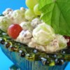 Green Grape Salad Recipe and Video - Green grapes are folded into a sweetened cream cheese and sour cream mixture freckled with pecan bits in this fruit salad.