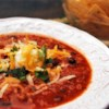 The Best Turkey Chili Recipe and Video - Turkey chili is truly delicious with toppings such as chopped onion, cilantro, chopped bell pepper, cheese, and sour cream.