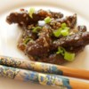 Sesame Beef Recipe and Video - Strips of round steak and chopped scallions are marinated with soy sauce and garlic, then quickly stir-fried with sesame seeds. Add a little sesame oil to the marinade if you like that flavor.