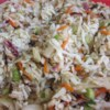 Dad's Asian Slaw Recipe - Bagged coleslaw mix is combined with crunchy dry ramen noodles, sunflower seeds, almonds, green onions, and a simple sweet vinaigrette for a tasty Asian-inspired coleslaw.