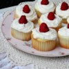 Raspberry White Chocolate Buttercream Cupcakes Recipe - Vanilla cupcakes filled with jewel-like raspberry filling and topped with rich white chocolate frosting are great for any occasion, from a shower to Easter day.