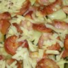 Kielbasa and Veggies Recipe - Veggies, potatoes and Polish sausage topped with melted Cheddar cheese make this a delicious casserole. This recipe is so simple, it's the one thing my husband makes himself! When I do it, I like to add green and red bell peppers, but it's really all in what you want to do with it. Enjoy!