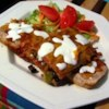Black Bean and Rice Enchiladas Recipe - These vegetarian black bean and rice enchiladas are just as satisfying as those served in restaurants.