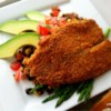 Baked Parmesan Tilapia Recipe and Video - Ranch dressing adds a zippy flavor to this crispy baked fish dinner.