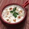Clam Chowder II Recipe - New England clam chowder is embellished with canned clams,  half-and-half, and condensed cream of potato soup in this recipe for a crowd.