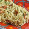 Spaghetti with Bacon Recipe - Spaghetti and bacon is simply flavored with garlic and Italian parsley in this quick and easy pasta dish.