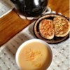 Creamy Cheddar Cheese Soup Recipe - Onions, butter and chicken broth comprise the base for this rich cheese soup.  Serve this as a comforting lunch on a brisk Fall day.