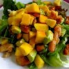 Chicken, Avocado and Mango Salad Recipe - This is a colorful and very tasty mix of chicken, mangos, and avocados in a spicy lime dressing.