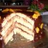 Decadent Chocolate Orange Cake Recipe - Moist orange cake layers separated by dark chocolate ganache and orange flavored cream cheese filling.